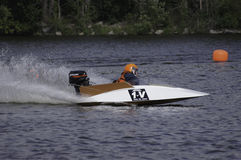 Hydroplane Boat Racing. Boat races featuring small hydroplane boats powered by outboard motors Stock Photos