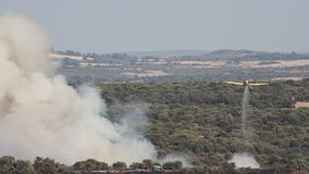 Hydroplane dumping water over wild fire stock video