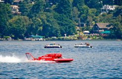 Hydroplane racing on lake. Side view of red hydroplane racing on Lake Washington during Seafair Sunday, Seattle, U.S.A Royalty Free Stock Image