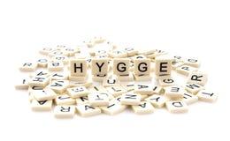 HYGGE écrit sur des tuiles de mot Photos stock