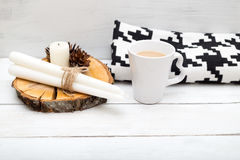 Hygge. A cup of hot chocolate and a blanket is on a wooden table Stock Photography