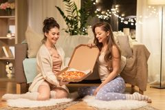 Happy female friends with pizza at home Royalty Free Stock Photography