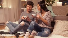 Happy couple drinking cacao at home stock video