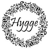 Hygge sign symbolizing Danish Life style surrounded by black and white flower elements in the shape of a circle Royalty Free Stock Photography