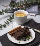 Hygge tea cozy home autumn brownie flat lay rustic winter stock photo