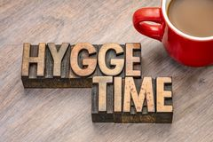 Hygge time in wood type. Hygge time word abstract in vintage letterpress wood type blocks, Danish lifestyle concept royalty free stock image