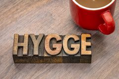 Hygge word in wood type. Hygge word abstract in vintage letterpress wood type blocks, Danish lifestyle concept stock image
