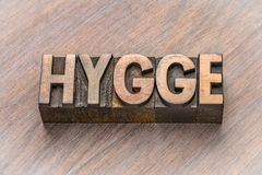 Hygge word in wood type. Hygge word abstract in vintage letterpress wood type blocks, Danish lifestyle concept stock photos