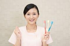 Hygiéniste dentaire de sourire photo stock