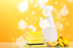 Hygiene cleanser with sponge. And glove on yellow background Royalty Free Stock Photos