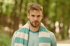 Hygiene and health. Man with towel on shoulder nature background. Sportsman just after training. Sport and wellness. Sportsman with towel ready visit swimming stock images