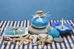 Hygiene items in blue. Spa background with some blue hygiene items on a bamboo mat Royalty Free Stock Photography