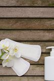 Hygiene items of a woman on a wooden surface. Background
