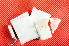 Hygiene items for womens critical days. Such as pad, menstrual cup, tampons. Top view, flat lay, concept of womens health issues stock image