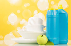 Hygiene kitchen cleanser. And empty dishware, background Stock Photos