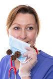 Hygiene in medicine. Doctor holding up a surgical mask in front of her mouth Royalty Free Stock Photography