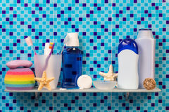 Hygiene products on shelf in bathroom Royalty Free Stock Photos