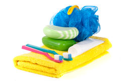Hygiene products: soap, toothbrush and paste, loofah, towel isolated on white background Royalty Free Stock Image