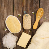 Hygiene products soap, towel, comb, sponge, pumice stone, flowers Stock Photo