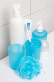 Hygiene supplies over tiled wall in bathroom Royalty Free Stock Photo