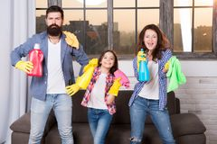 Hygiene. We will make your world spotless. Family clean house. Happy family hold cleaning products. Mother, father and. Daughter clean house. hygiene at home royalty free stock image