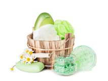 Hygienic accessories of green color. Toiletries of green color: natural soap, washcloths, shampoo, shower gel, bath salt and massager are on white background royalty free stock photo