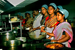 Hygienic Cooking. A group of Indian village women are practicing as per instruction in a training program of hygienic and healthy use of kitchen during cooking stock photos