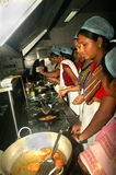 Hygienic Cooking. A group of Indian village women are practicing as per instruction in a training program of hygienic and healthy use of kitchen during cooking royalty free stock images