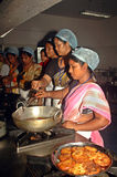 Hygienic Cooking. A group of Indian village women are practicing as per instruction in a training program of hygienic and healthy use of kitchen during cooking royalty free stock photography