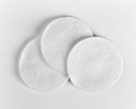 Hygienic cotton disks. Three white hygienic cotton disks stock images