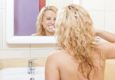 Hygienic Dental Procedure. Caucasian Woman With Modern Electric Toothbrush in Bathroom. Stock Photography