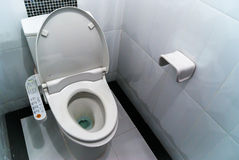 Hygienic and high technology of the toilet bowl. Automatic flush royalty free stock photos