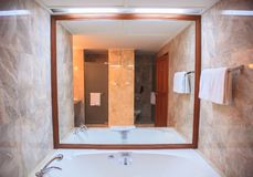 Hygienic Modern Luxury Bathroom Facility Design background. Hotel Resort Accommodation Interior Architecture, Decoration concept. For toilet, washbasin, sink royalty free stock photos