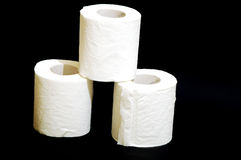 Hygienic paper. Composition on black bottom of 3 rolls of hygienic paper royalty free stock image