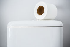 Hygienic paper on white toilet tank Royalty Free Stock Images
