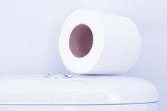 Hygienic paper on white toilet tank. Closeup royalty free stock photography