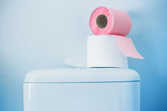 Hygienic paper on white toilet tank. Closeup royalty free stock image