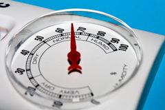 Hygrometer instrument. Showing normal humidity isolated on blue background Royalty Free Stock Photos