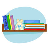 Hylla med böcker för barn Royaltyfri Fotografi