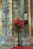 Hymn Board. With Red Poppys and Carnations Flower Display in English Abby royalty free stock photos