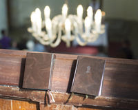 Hymn books in a church. Closeup of hymn books on a wooden pew in a church Royalty Free Stock Photo