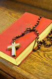 Hymnal  book and wooden rosary bead. Detail Royalty Free Stock Images