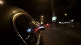 The car in the night city traffic. Hyper lapse of the car in the night city traffic stock video footage
