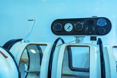 Hyperbaric oxygen therapy chamber tank. Hyperbaric Oxygen Therapy or HBOT chamber tank used for specialised medical treatment for injuries in hospital clinic stock images