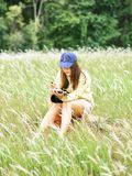 Cute young woman lifestyle with fashion relax wear in the field. HyperFocal: cute young woman lifestyle with fashion relax wear happiness activity in the field royalty free stock photo