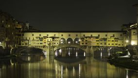 Hyperlapse at night of Ponte Vecchio in 4k. October 2018: Tourists on Ponte Vecchio during the evening. The shops are closing and the lights are turned off stock video