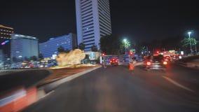 Hyperlapse på vägarna av staden av Jakarta på natten Indonesien arkivfilmer