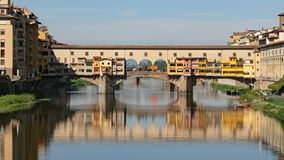 Hyperlapse of Ponte Vecchio, Florence. Hyperlapse of Ponte Vecchio, medieval stone bridge over of Arno river at clear summer day in Florence, Italy stock video