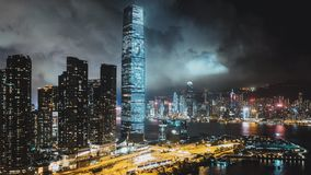 Hyperlapse time-lapse of Hong Kong cityscape at night at Victoria Harbour, drone aerial view