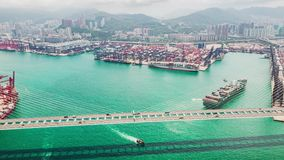 Hyperlapse time-lapse of Stonecutters bridge and Hong Kong port with cargo container ship, crane, and car traffic